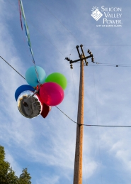 balloons in power lines with logo