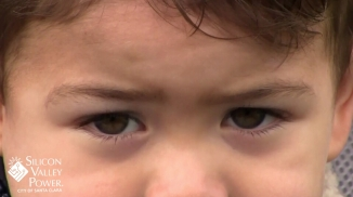 child stare with logo