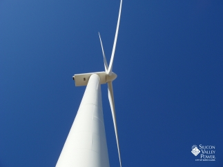 Looking up at wind turbine - with logo