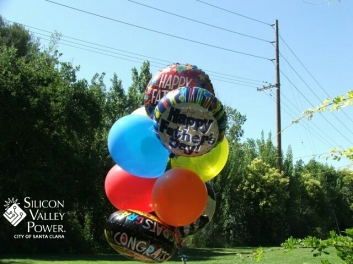 Boquet of balloons near power lines