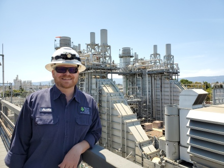 Silicon Valley Power Generation technician wearing a hard hat with the DVR power plant in the background