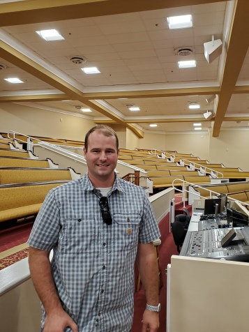 North Valey Baptist staff member stands in auditorium under new lighting
