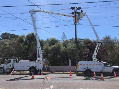 Two Bucket trucks working on a Utility Pole